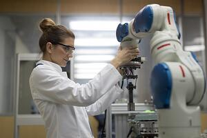 Woman working with cobot
